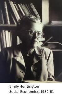 grayscale portrait of Emily Huntington looking into the distance at 45 degree angle, wearing a blazer, against a background of books