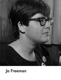 image of Jo Freeman with thick framed cat-eye classes and short haircut, looking away from the camera at 45 degrees