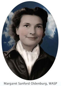 portrait of Margaret Sanford Oldenburg, WASP smiling while looking into the distance against blue sky and white clouds