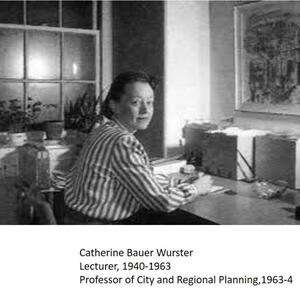 grayscale photo of Catherine Bauer Wurster looking over her shoulder in neutral expression, wearing a striped collared long-sleeved shirt in an office setting