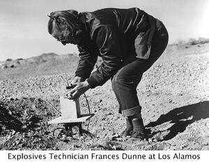 image of explosives technician Frances Dunn, hunched over technology, at Los Alamos