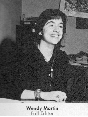 photo of wendy martin smiling with elbow resting on table against an office background