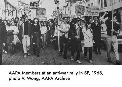 group of AAPA members at anti-war rally in San Francisco, holding signs