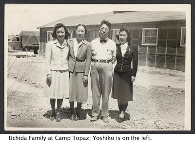 sepia image of Uchida family of 4 at Camp Topaz with Yoshiko on the far left.